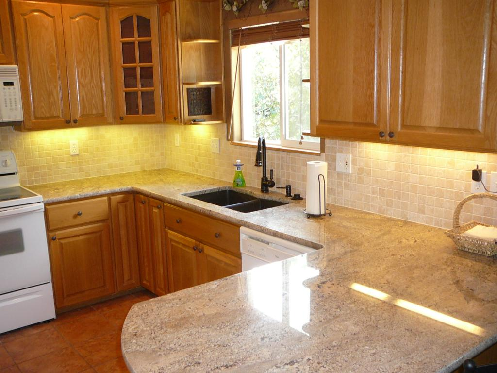 After shot. Note: I only did backsplash. I do not install granite tops