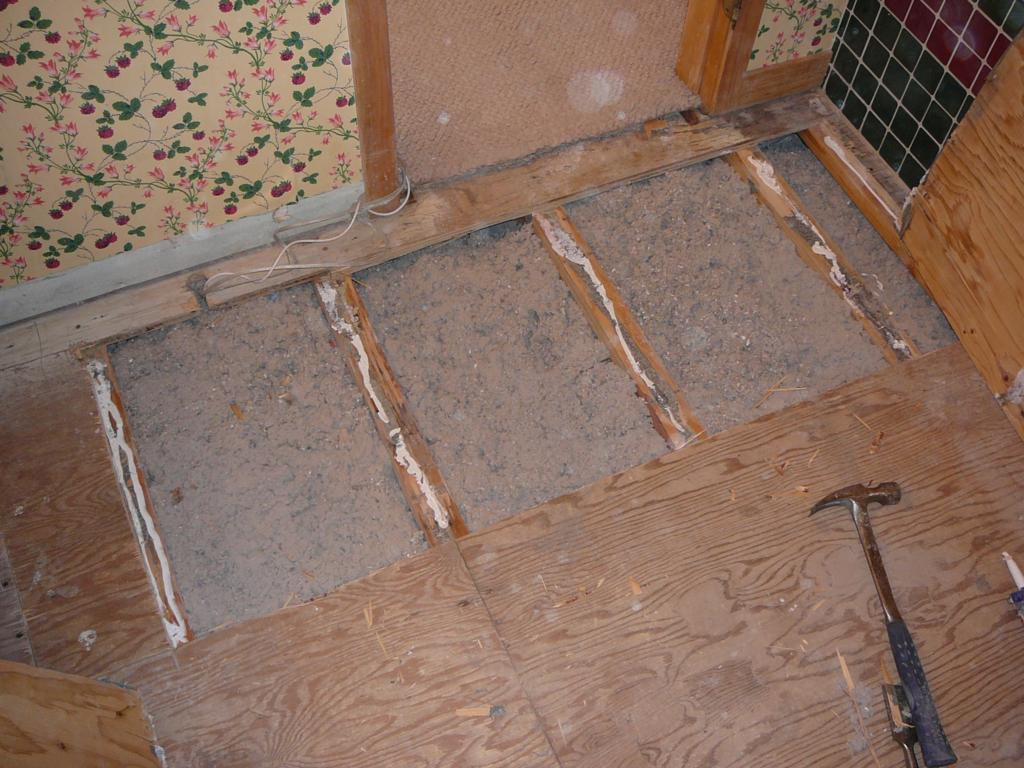I use blown insulation to avoid ripping up the old sub-floor.