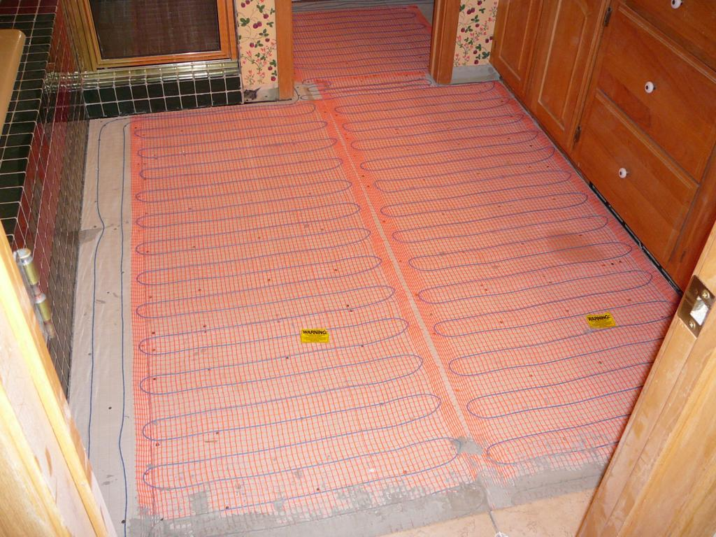 Radiant heat mats before tile goes down.