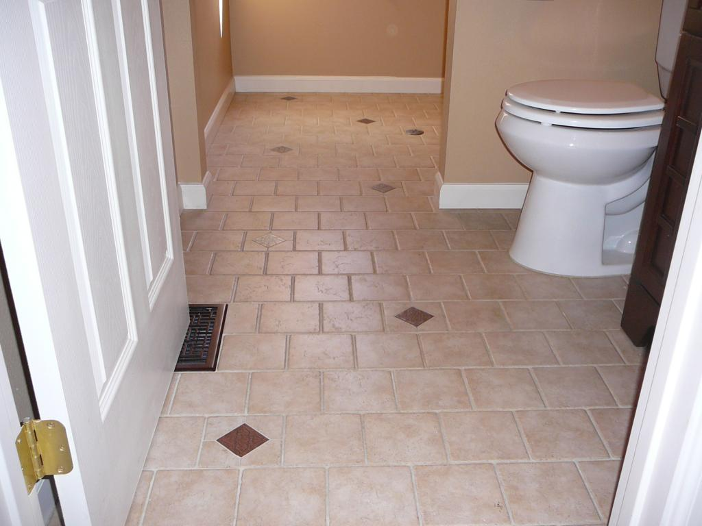 New tile floor in place of linoleum. I also remodeled this entire bathroom & laundry room.