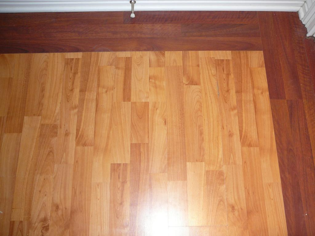 Here's something you probably haven't seen. This is done all the time on real hardwood floors. But THIS  is a lock ridge Laminate floating floor. If you understand how these floors go together, then you know why this isn't technically  possible with a floating floor. Ask your flooring guy if he can do it. I'll bet the answer is no. ......But I can.  BTW, these pics where taken after the floor had be down for 5 years and it still looks like the day I installed it.