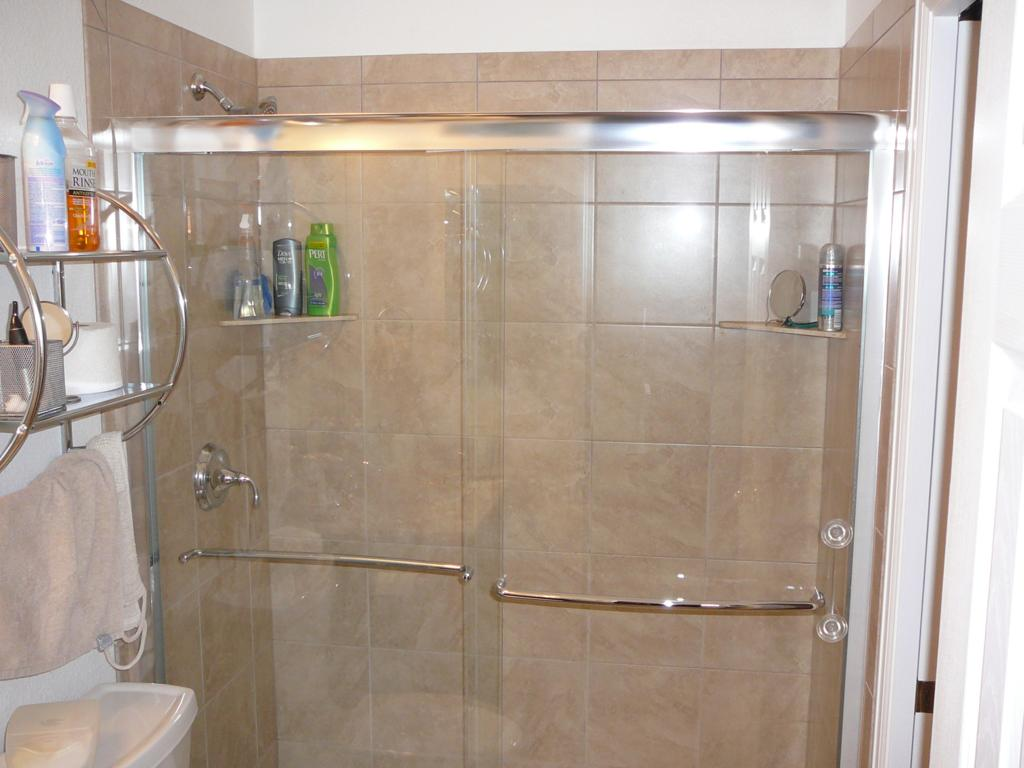 This was formerly a fiberglass bathtub. I converted it to a tile shower with fiberglass pan.